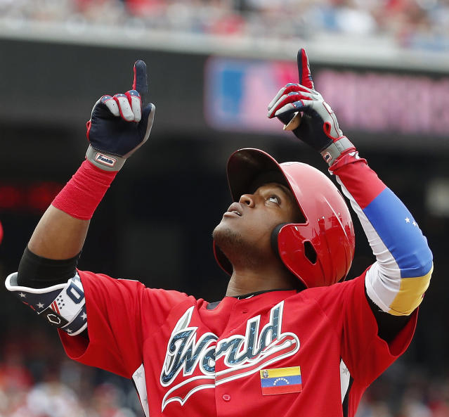 Work Team Luis Basabe of the Chicago White Sox celebrates a two-run home run against the U.S. Team in the 3rd inning of the All-Star Futures baseball game, Sunday, July 15, 2018, at Nationals Park, in Washington. The the 89th MLB baseball All-Star Game will be played Tuesday. (AP Photo/Alex Brandon)
