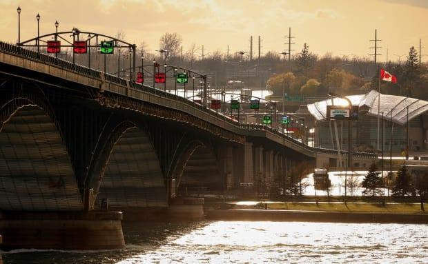 The Peace Bridge and the Canadian border are seen from Buffalo, N.Y., on April 22. Pressure is building on the U.S. side to get travel moving. (Lindsay DeDario/Reuters - image credit)