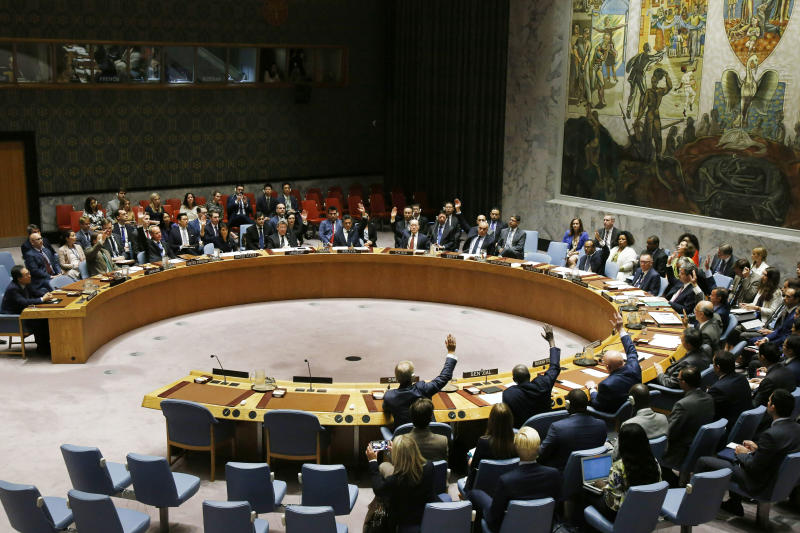 FILE- In this Sept. 11, 2017, file photo, the United Nations Security Council votes to pass a new sanctions resolution against North Korea during a meeting at U.N. headquarters. After the breakdown in North Korean leader Kim Jong Un's summit with U.S. President Donald Trump in Hanoi, his efforts to get out from under sanctions that are keeping him from doing that have reached an impasse. More than 10,000 North Korean laborers still employed in Russia, many working in the logging industry in the Russian Far East, are being kicked out by the end of this year as the U.N. sanctions resolution takes effect. (AP Photo/Jason DeCrow, File)