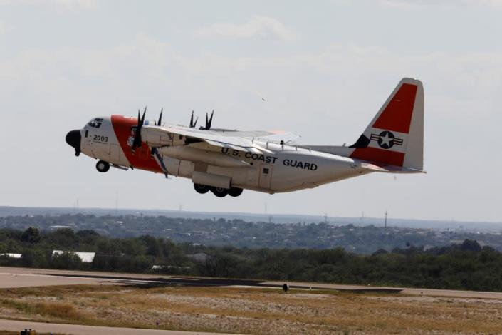 A U.S. Coast Guard airplane with migrants on board departs the Del Rio International Airport as U.S. authorities accelerate removal of migrants at border with Mexico, in Del Rio