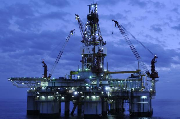 Oil & Gas Stock Roundup: Exxon's Restructuring, Shell's Cash Dividend Resumption & More