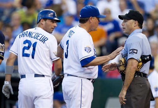 Kansas City Royals manager Ned Yost (3) talks with home plate umpire Dan Iassogna, right, after Jeff Francoeur (21) was ejected from the game during the second inning of a baseball game against the Milwaukee Brewers at Kauffman Stadium in Kansas City, Mo., Thursday, June 14, 2012. (AP Photo/Orlin Wagner)