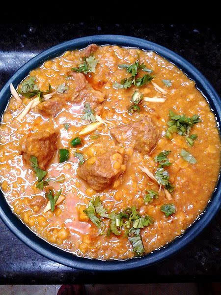 """<p>A wonderful combination of mutton with Chana dal. To make Dal Gosht, soak 1 cup chana dal for 1-2 hours. In a pressure cooker, saute one sliced onion in oil alongwith 1 tsp ginger garlic paste & 1 chopped green chili. Add 500 gms cleaned mutton pieces & roast till brown. Add turmeric powder, chili powder, garam masala powder & salt to taste. Add soaked chana dal with enough water & pressure cook till tender. Serve garnished with chopped mint & coriander leaves. """"Creative Commons Daal gosht"""" by Syedandy is licensed under CC BY 4.0 </p>"""