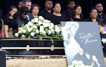 Nadene Lomu (L), widow of late rugby legend Jonah Lomu, walks past his casket during a memorial service at Eden Park in Auckland on November 30, 2015