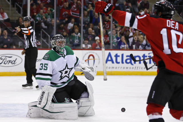 New Jersey Devils' Jean-Sebastien Dea (10) celebrates scoring a goal past Dallas Stars goaltender Anton Khudobin in the second period of an NHL hockey game Tuesday, Oct. 16, 2018, in Newark, NJ. (AP Photo/Adam Hunger)