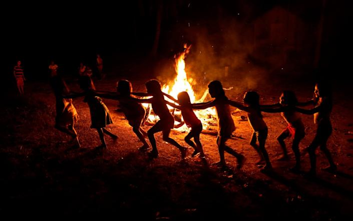 Tenetehara Indigenous children play around a campfire during a festival in the Alto Rio Guama Indigenous Reserve - AP
