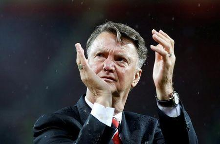 FILE PHOTO: Manchester United manager Louis van Gaal applauds fans during a lap of honour after the game