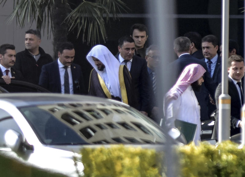 Saudi Arabia's top prosecutor Saud al-Mojeb, center left, leaves his hotel to go to his country's consulate in Istanbul, Tuesday, Oct. 30, 2018. The Turkish fiancee of slain journalist Jamal Khashoggi has called on U.S. President Donald Trump and other leaders to ensure that his death in Istanbul is not covered up, while Saudi Arabia's top prosecutor on Tuesday visited the Saudi Consulate where officials from his government killed the writer. (Can Erok/DHA via AP)