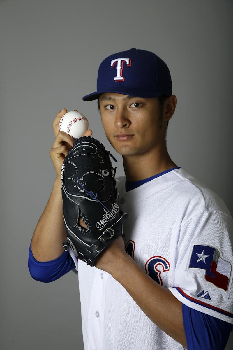 FILE - In this Feb. 25, 2014 file photo, Texas Rangers' Yu Darvish poses during photo day at spring training in Surprise, Ariz. Darvish has been scratched from his scheduled start in Monday's, April 31, 2014 season opener because of stiffness in his neck. The announcement Tuesday came a day after Darvish stopped throwing while playing catch. (AP Photo/Tony Gutierrez, File)