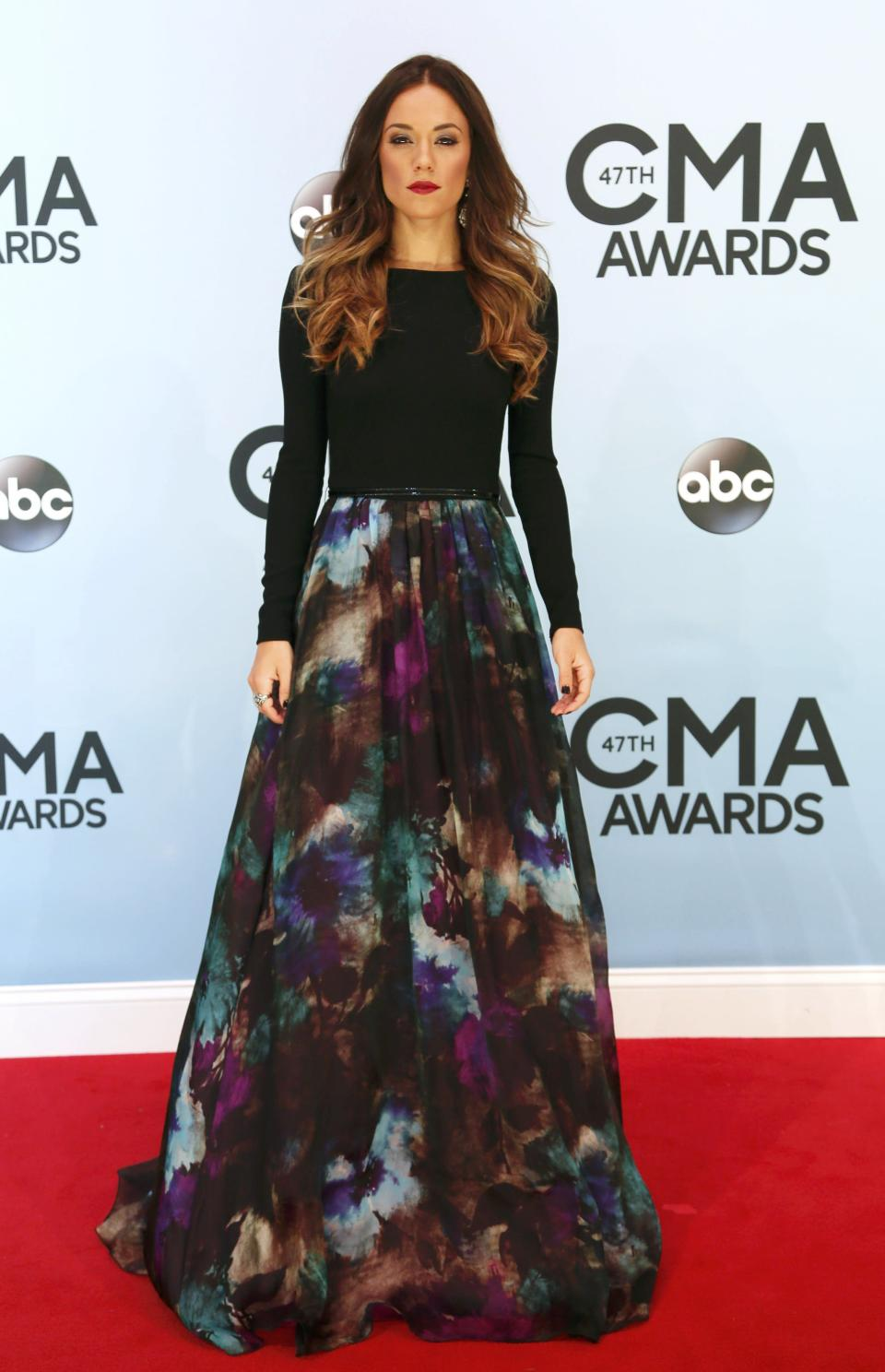 Jana Kramer poses on arrival at the 47th Country Music Association Awards in Nashville, Tennessee November 6, 2013. REUTERS/Eric Henderson (UNITED STATES - Tags: ENTERTAINMENT)