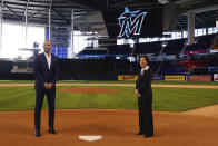 In this photo provided by the Miami Marlins, new Miami Marlins general manager Kim Ng, right, and CEO Derek Jeter pose for a photo at Marlins Park stadium before Ng was introduced during a virtual news conference, Monday, Nov. 16, 2020, in Miami. Ng discussed her climb to become the first female GM in the four major North American professional sports leagues. (Joseph Guzy/Miami Marlins via AP)