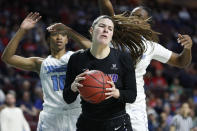 Portland's Alex Fowler (12) grabs a rebound over San Diego during the first half of an NCAA college basketball game in the final of the West Coast Conference women's tournament Tuesday, March 10, 2020, in Las Vegas. (AP Photo/John Locher)