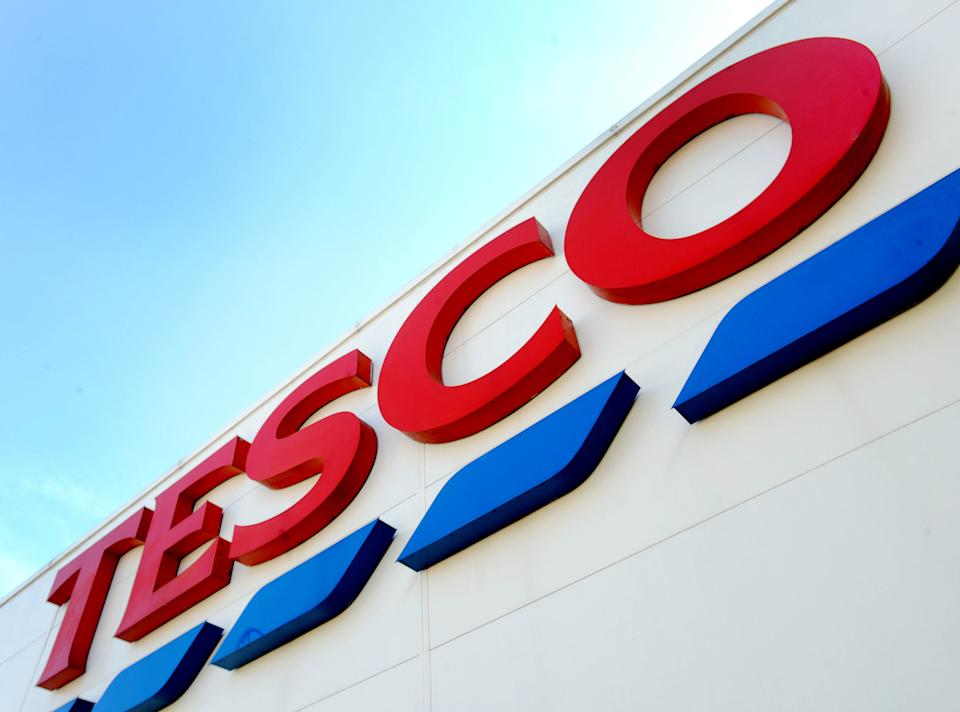 File photo dated 26/08/16 of a Tesco sign. Tesco sales have surged over the past three months, after rapidly expanding its online business amid increased demand for grocery deliveries in the face of coronavirus.