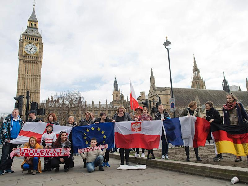 Protesters pose for a photograph with flags from England, European Union, Poland, France and Germany in front of Parliament: Getty