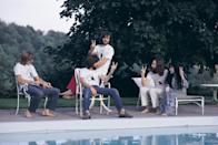<p>John Lennon, Yoko Ono, and Eric Clapton throw peace signs as they lounge poolside in 1969.</p>