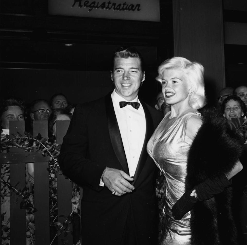 <p>Jayne stole the show at the 1960s Golden Globes with a form fitting metallic dress along with long black gloves and a fur shall that exuded pure elegance. </p>