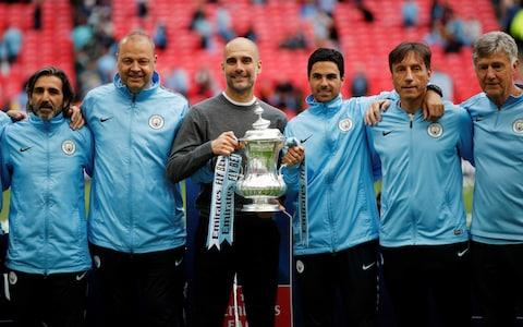 Pep Guardiola and his coaching staff - Credit: REUTERS