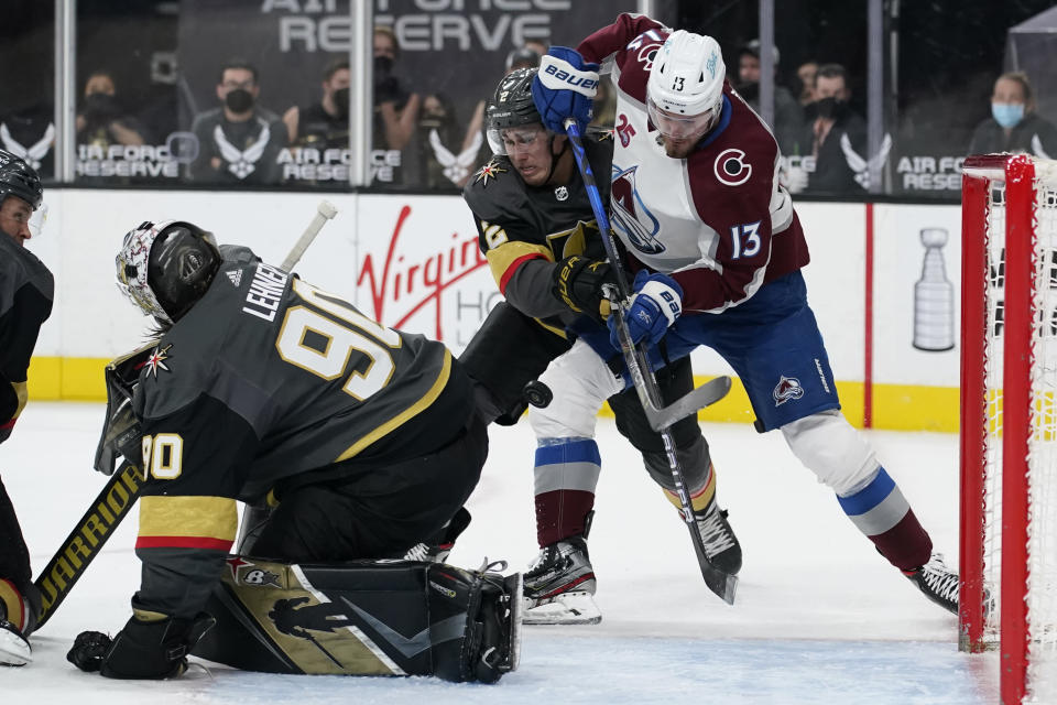 Colorado Avalanche right wing Valeri Nichushkin (13) attempts a shot against Vegas Golden Knights defenseman Zach Whitecloud (2) during the third period of an NHL hockey game Monday, May 10, 2021, in Las Vegas. (AP Photo/John Locher)