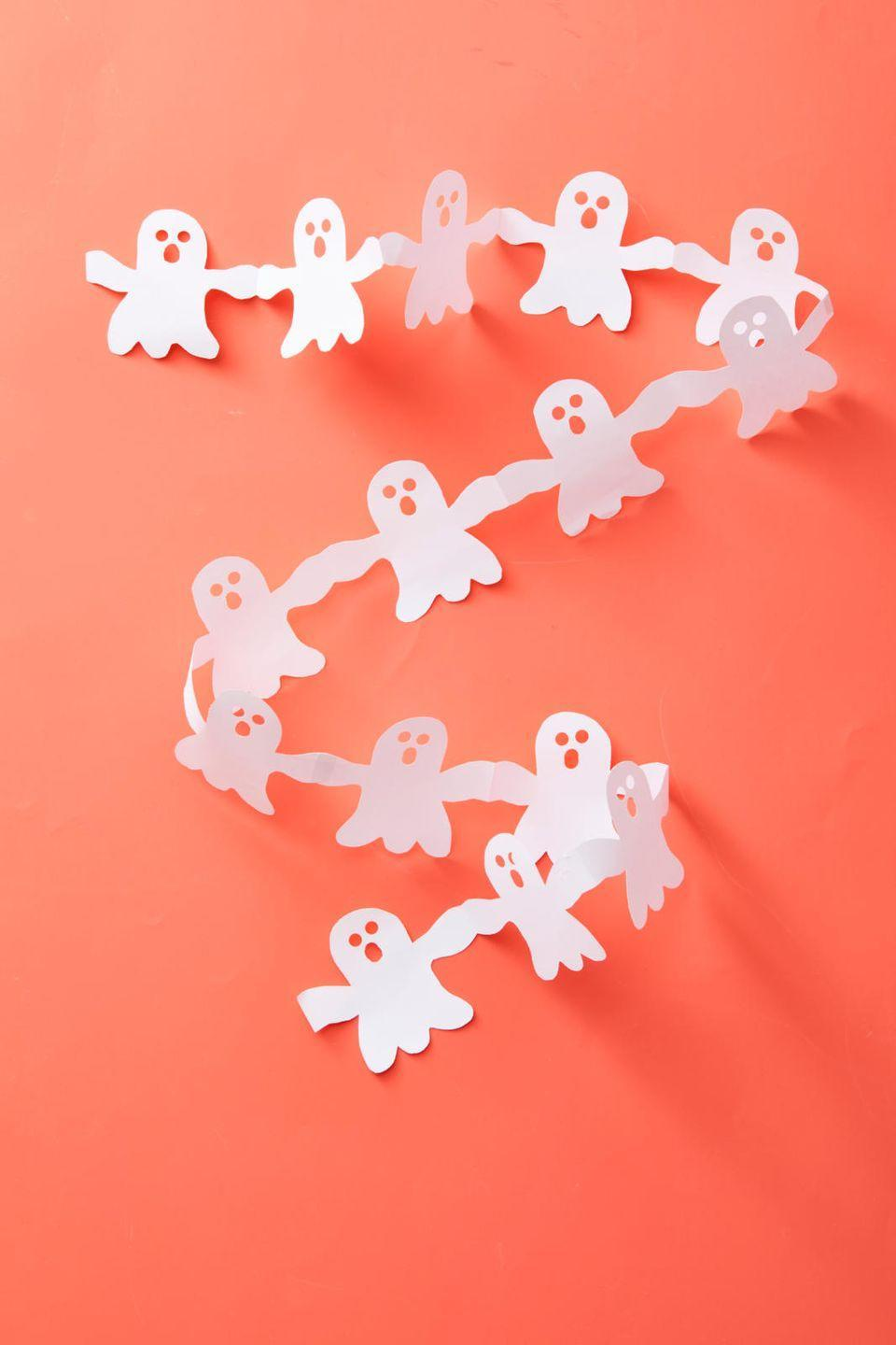 "<p>These cute ghosts make easy decor for just about anywhere in your house. Start by accordion folding paper into approximately 3"" sections. Then, trace a ghost shape on the top piece, making sure it has arms that connect to the edges of the paper, and cut out the shape. Repeat with more paper if you want to make it longer, and attach the strands with clear tape. </p><p><strong>RELATED:</strong> <a href=""https://www.goodhousekeeping.com/holidays/halloween-ideas/g421/halloween-decorating-ideas/"" rel=""nofollow noopener"" target=""_blank"" data-ylk=""slk:The Most Incredible Halloween Decoration Ideas"" class=""link rapid-noclick-resp"">The Most Incredible Halloween Decoration Ideas </a></p>"