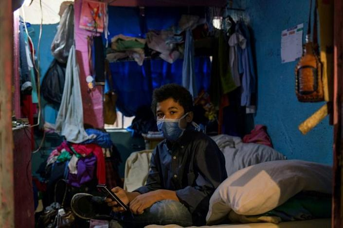 Jonathan Figueroa, 14, in the room he shares with his mother in the Bello Campo district of Caracas, in October 2020
