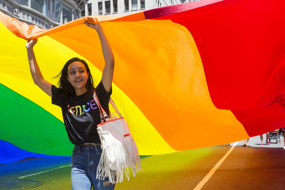 A parade goer holds a giant rainbow flag at the annual Pride Parade on Sunday, June 29, 2019 in New York, NY. This years annual Pride Parade celebrates the 50th Anniversary of the Stonewall Uprising and a half-century of LGBTQ+ liberation. (Photo by Erin Lefevre/NurPhoto via Getty Images)