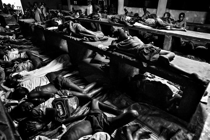 Children sleep closely packed together in a black and white image