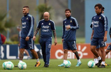 Football Soccer - Argentina's national soccer team training - World Cup 2018 Qualifiers - Buenos Aires, Argentina - August 29, 2017 - Argentina's head coach Jorge Sampaoli and players Mauro Icardi, Lionel Messi and Paulo Dybala walk during a training session ahead a match against Uruguay. REUTERS/Marcos Brindicci