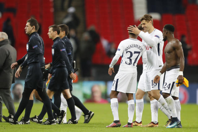 Tottenham's Fernando Llorente, second right, Kyle Walker-Peters, center left, and Serge Aurier celebrated their win against APOEL after the end of the Champions League Group H soccer match between Tottenham and APOEL Nicosia in London, Wednesday, Dec. 6, 2017. (AP Photo/Frank Augstein)