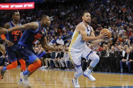 Mar 16, 2019; Oklahoma City, OK, USA; Golden State Warriors guard Stephen Curry (30) drives to the basket ahead of Oklahoma City Thunder guard Deonte Burton (30) during the first half at Chesapeake Energy Arena. Mandatory Credit: Alonzo Adams-USA TODAY Sports