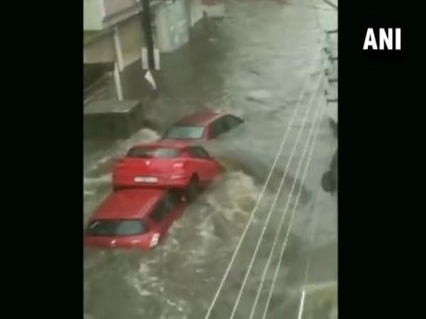 The visual of the three cars piled up on a waterlogged road in Hyderabad on Wednesday. (Photo/ANI)