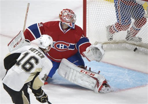 Pittsburgh Penguins' Brandon Sutter (16) scores against Montreal Canadiens goaltender Carey Price during overtime of an NHL hockey game Saturday, March 2, 2013, in Montreal. (AP Photo/The Canadian Press, Graham Hughes)