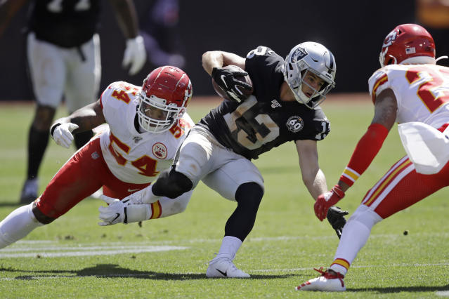 Oakland Raiders wide receiver Hunter Renfrow (13) is stopped with the ball by Kansas City Chiefs outside linebacker Damien Wilson (54) and free safety Juan Thornhill, right, during the first half of an NFL football game Sunday, Sept. 15, 2019, in Oakland, Calif. (AP Photo/Ben Margot)
