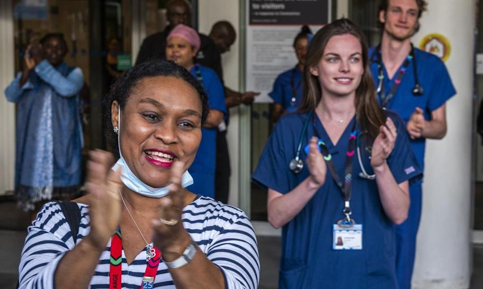 Hospital staff outside the Chelsea and Westminster during the Clap for Carers on 28 May.