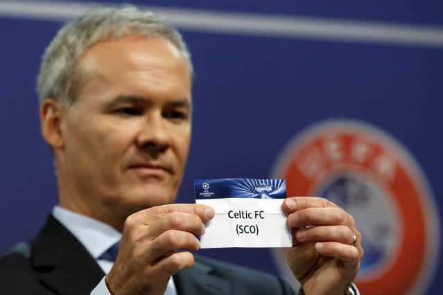 Giorgio Marchetti, UEFA Director of professional football, shows the ticket of Scottish club Celtic FC, during the draw of the games for the Champions League 2014/15 playoff rounds, at the UEFA headquarters in Nyon, Switzerland, Friday, Aug. 8, 2014. (AP Photo/Keystone, Salvatore Di Nolfi)