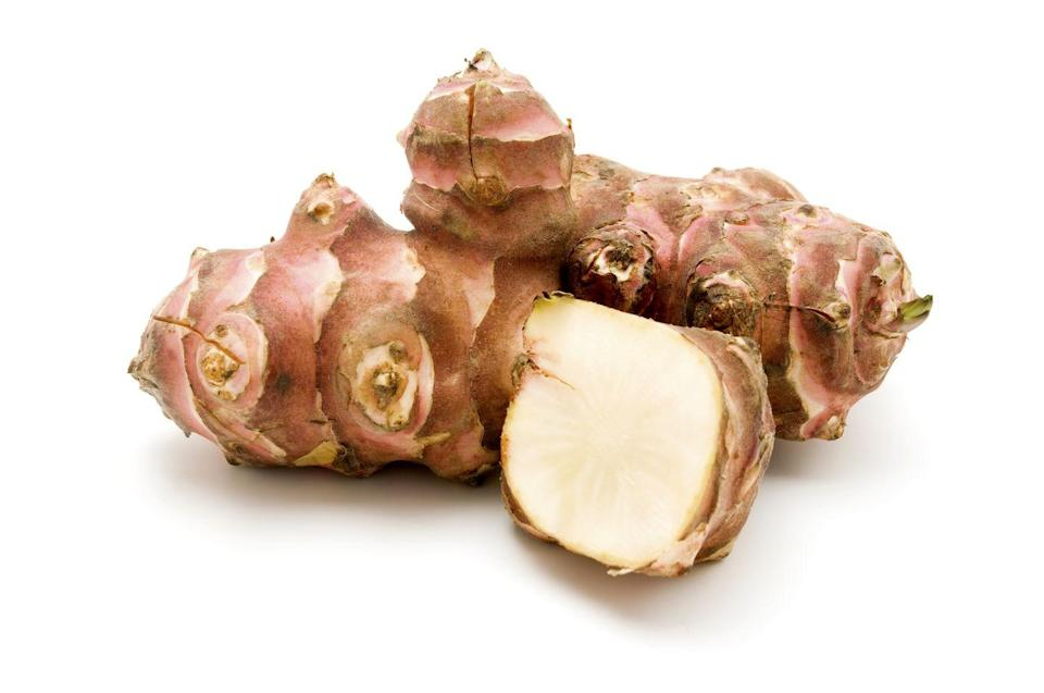 """<p>This root vegetable is neither from Jerusalem (it's derived from the Italian word for sunflower, """"girasole""""), nor is it an artichoke: but don't let that be cause for mistrust. Roasted, sautéed or puréed into a creamy soup, it has a nutty, sweet taste. It's also a top source of inulin, a type of fibre that the bacteria in your digestive system feed on, creating a healthier microbiome that is linked with reduced anxiety and swifter fat loss. Praise be.</p>"""