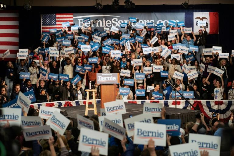 Supporters of Democratic presidential candidate Bernie Sanders wait for results at his caucus night watch party in Des Moines, Iowa (AFP Photo/kerem yucel)