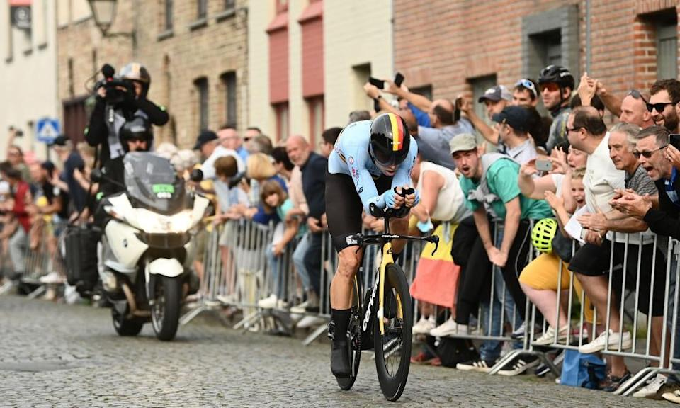 Wout van Aert is cheered on by spectators lining the streets of Bruges.