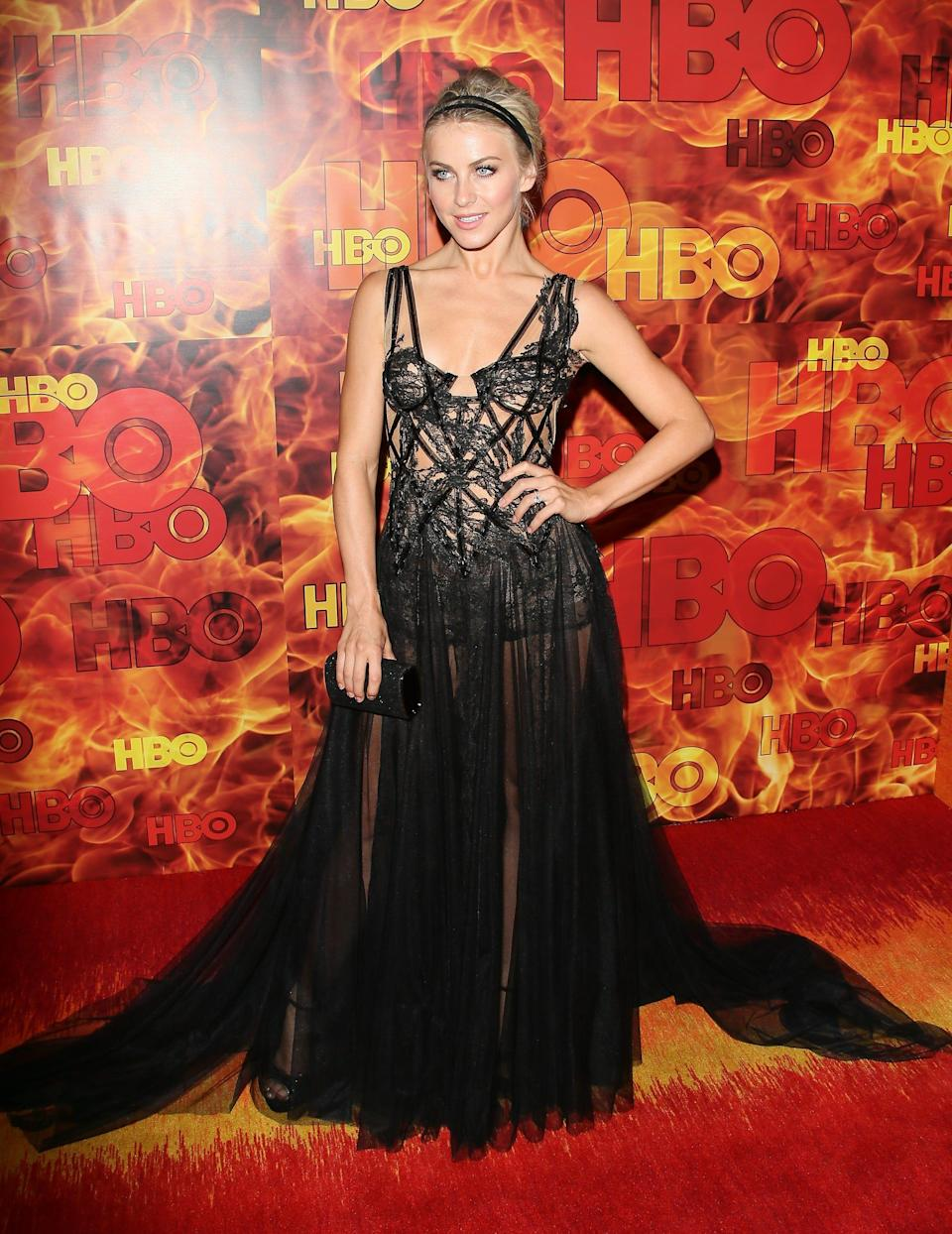 Julianne Hough at the 2015 Emmys in a black partially sheer dress.