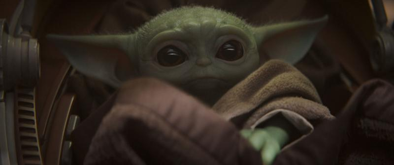 There's a scientific reason why people are obsessed with Baby Yoda. (Photo: Disney+)