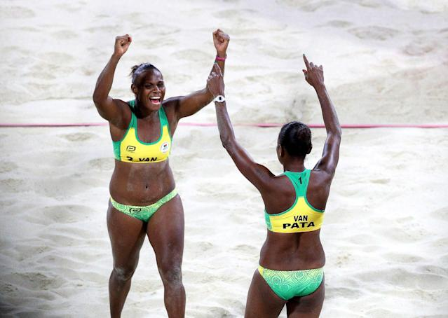 Beach Volleyball - Gold Coast 2018 Commonwealth Games - Women's Bronze Match - Cyprus v Vanuatu - Coolangatta Beachfront - Gold Coast, Australia - April 12, 2018. Miller Pata and Linline Matauata of Vanuatu celebrates. REUTERS/Athit Perawongmetha