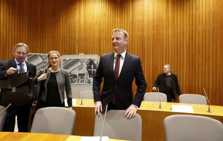 North Rhine Westphalia state Interior Minister Ralf Jaeger (C) arrives for an internal commitee meeting of North-Rhine Westphalia state parliament in Duesseldorf, Germany January 11, 2016. REUTERS/Ina Fassbender