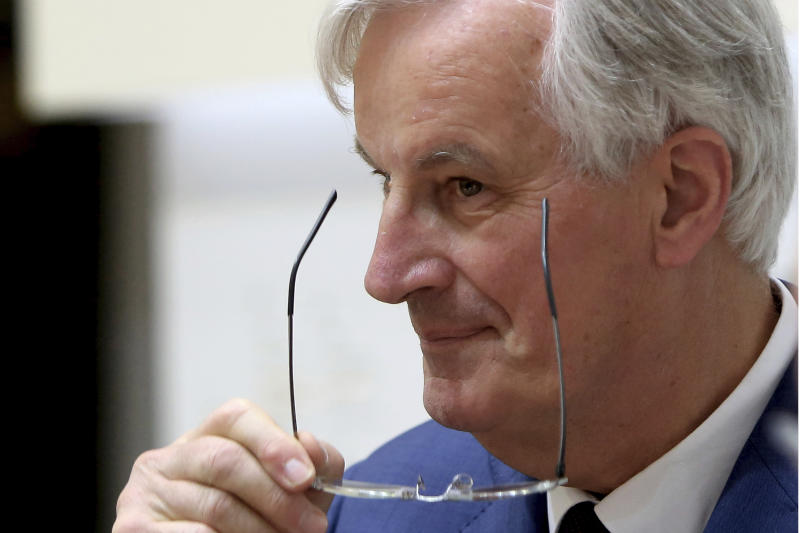 The European Union's chief Brexit negotiator Michel Barnier adjusts his glasses after talks to the media with Cyprus' foreign minister Nicos Christodoulides at the foreign ministry in Nicosia, Cyprus, Monday, May 20, 2019. Barnier says ratifying the withdrawal agreement is the only way for the UK to give itself time to figure out with the bloc what to do about a border with Northern Ireland. (AP Photo/Petros Karadjias)