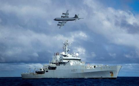<span>Survey ship HMS Echo and a Lockheed P-3 Orion during the early days of the search in the southern Indian Ocean</span> <span>Credit: Press Association </span>
