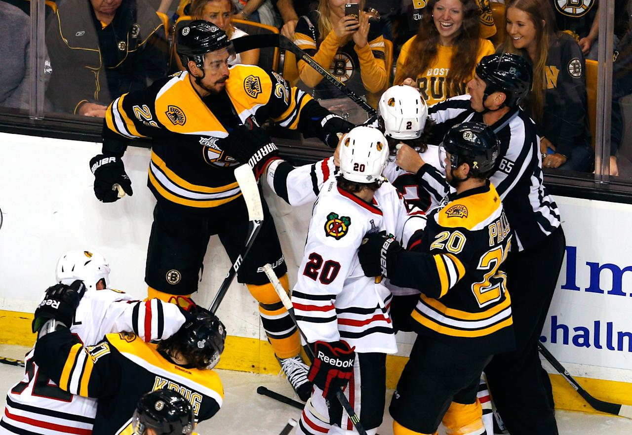 BOSTON, MA - JUNE 19: Chris Kelly #23 of the Boston Bruins is separated from Duncan Keith #2 of the Chicago Blackhawks during the first period in Game Four of the 2013 NHL Stanley Cup Final at TD Garden on June 19, 2013 in Boston, Massachusetts. (Photo by Jim Rogash/Getty Images)
