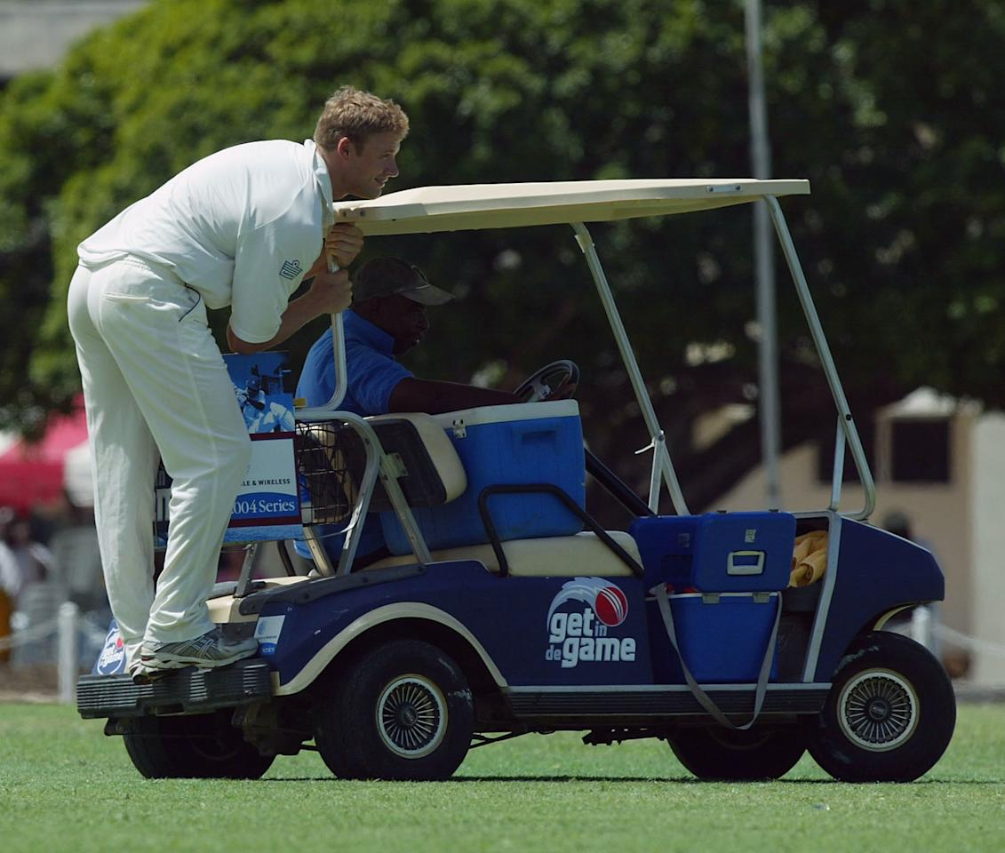 BRIDGTOWN, BARBADOS - MARCH 28:  Andrew Flintoff of England catches a ride on the drinks cart during the tour match between Carib Beer XI and England at the 3 W's Oval, University of West Indies, on March 28 2004, in Bridgetown, Barbados. (Photo by Ben Radford/Getty Images)