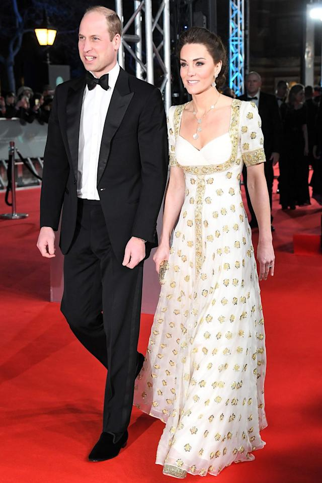 """<p>Prince William and Kate Middleton dazzled as they walked the red carpet at the prestigious <a href=""""http://www.bafta.org/"""">BAFTA</a> event at London's Royal Albert Hall, marking the couple's <a href=""""https://people.com/royals/kate-middleton-sustainable-re-wear-baftas/"""">fourth consecutive year attending</a>. All attendees were provided with a<a href=""""https://www.arts.ac.uk/__data/assets/pdf_file/0029/196355/00180_LCF_BAFTA_190x260_4.pdf"""">sustainable fashion guide</a> this year asking guests to re-wear, rent or buy vintage. Kate adhered to the guidelines, rewearing a gorgeous gold and white Alexander McQueen gown, which was <a href=""""https://people.com/royals/kate-middleton-style-asia-tour-dresses/"""">previously worn during a 2012 state dinner in Malaysia.</a> The mom of three accessorized with a necklace and earrings from Van Cleef and Arpels — that cost over $15,000 — as well as gold Jimmy Choo heels.</p>"""