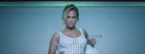 <p>Sitting in the interrogation room, J.Lo is poised in a white striped, sheer dress with cutouts by Genny.</p>