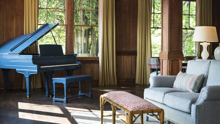 A gathering place off the inn's main lobby features a blue baby grand piano. - Credit: Ball & Albanese