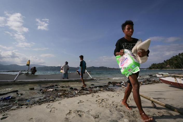 Getting vital supplies to affected areas has proved hugely challenging (AFP Photo/MUHAMAD NASRUN)