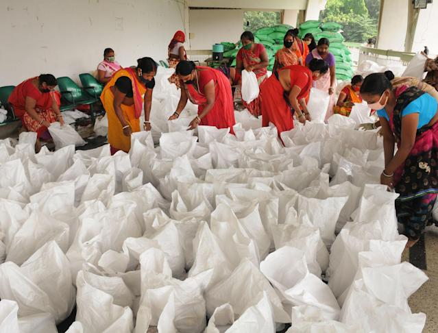 Volunteers packs food relief packets for people in the states flood-hit areas, at SK Memorial Hall, on July 26, 2020 in Patna, India. (Photo by A P Dube/Hindustan Times via Getty Images)